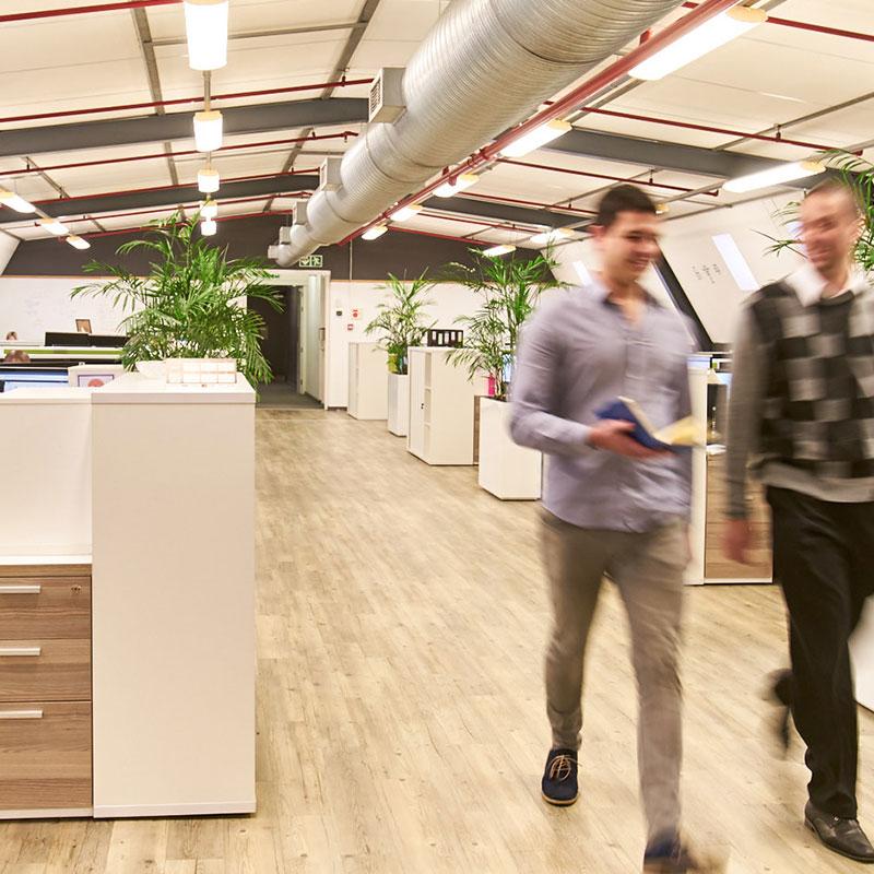 Employees walking in Van As Associates department